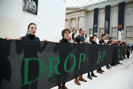 Activists are seen holding a banner during during the